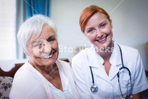 Portrait of happy doctor and patient