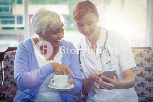 Smiling doctor and patient taking a selfie