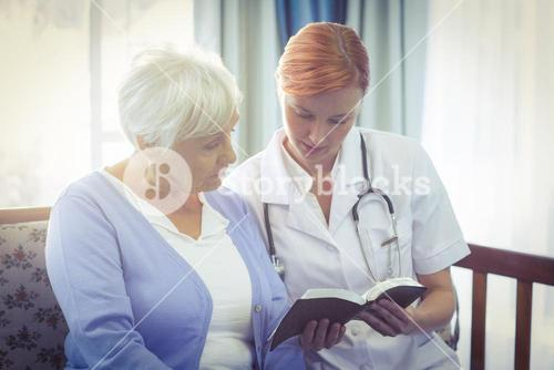 Doctor and patient reading a book