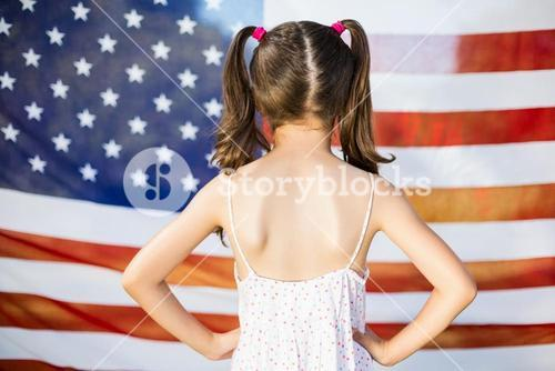 Young girl standing with hands on hip
