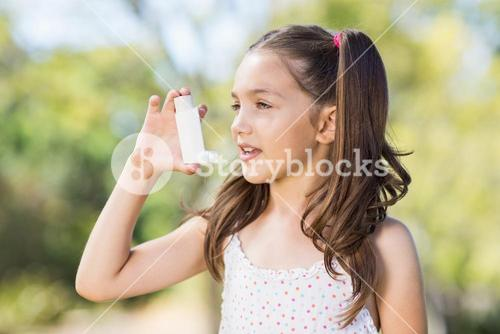 Girl using an asthma inhaler