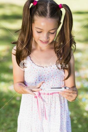 Girl testing diabetes on glucose meter