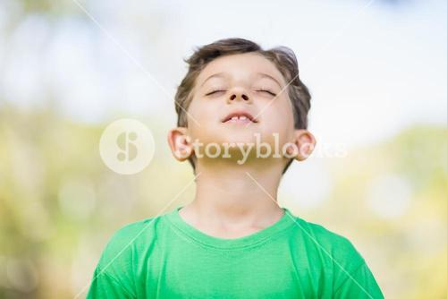 Young boy with eyes closed