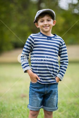 Smiling boy standing with hands in pocket
