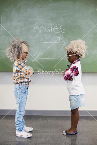Kids wearing wig standing face to face in classroom