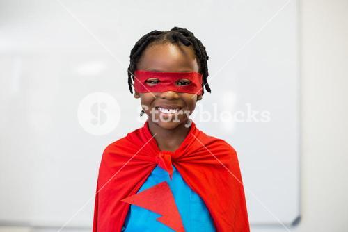 Smiling boy pretending to be a superhero