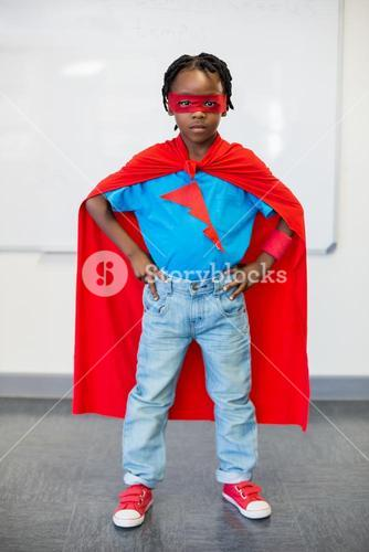 Portrait of boy pretending to be a superhero