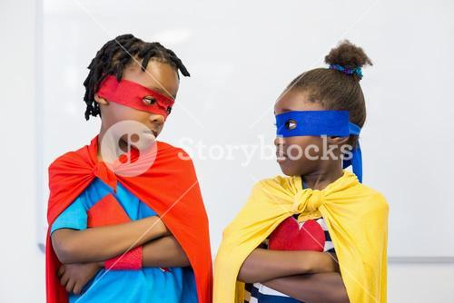 Boy and girl pretending to be a superhero