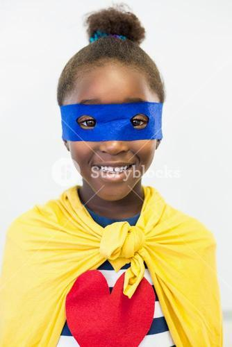 Smiling girl pretending to be a superhero