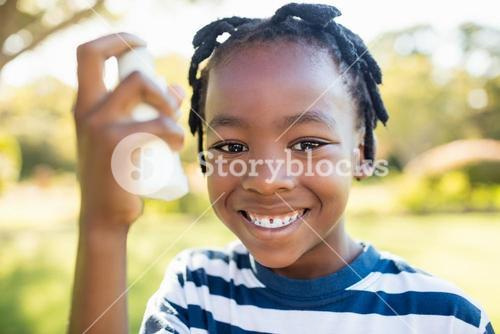 Kids holding an object and smiling
