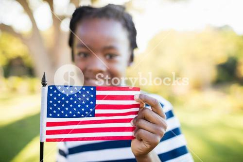 Happy child showing a usa flag