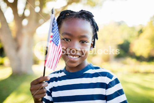 happy child showing usa flag