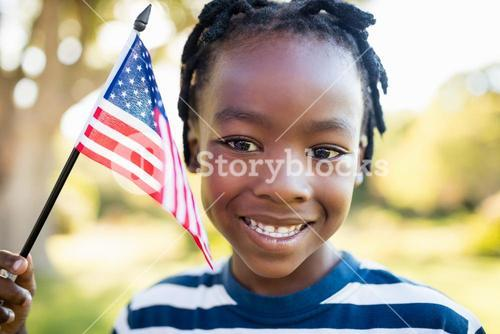 Happy child holding an usa flag