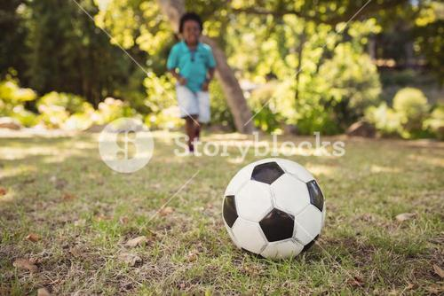 happy child playing football