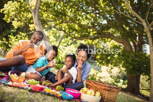 Happy family eating together
