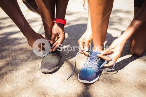 Focus on family doing laces