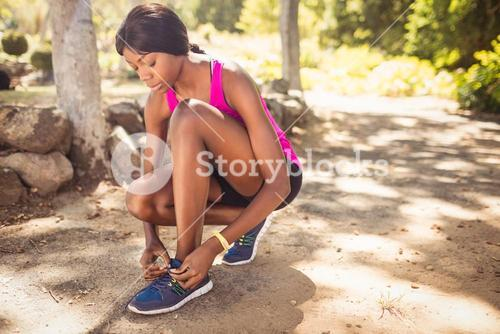 Woman doing his laces