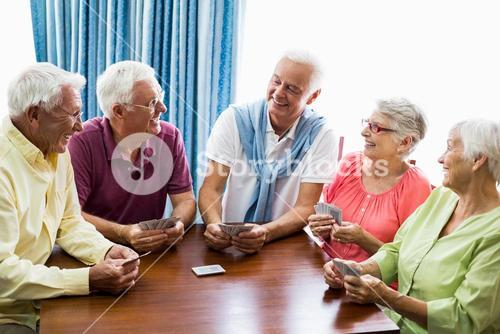 Seniors playing cards together