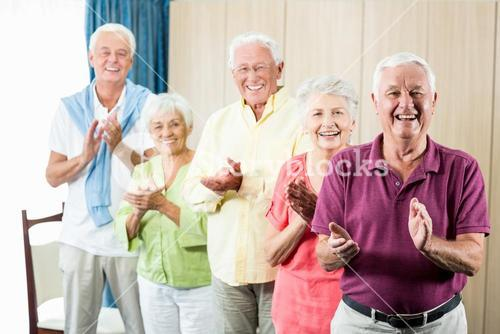 Seniors clapping hands
