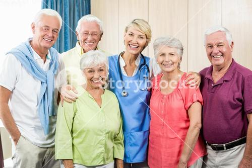 Seniors and nurse standing in a row