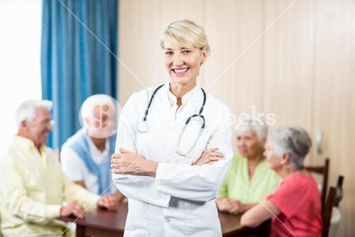 Nurse standing with arms crossed
