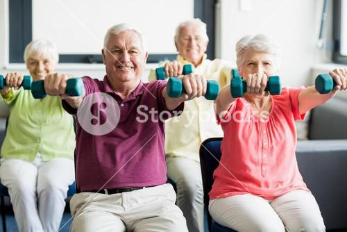Seniors using weights