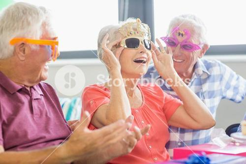 Seniors wearing funny glasses