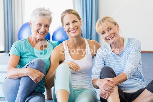 Instructor and senior women sitting