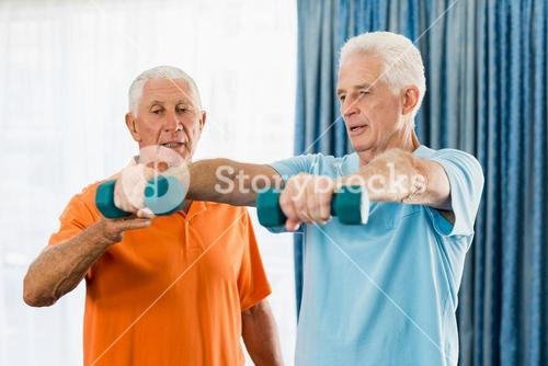 Senior exercising with weights