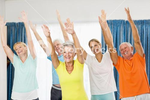 Instructor doing exercises with seniors