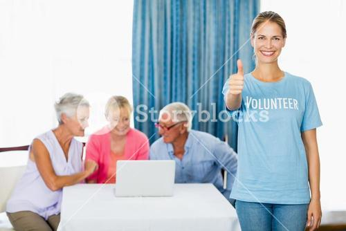 Volunteer with thumbs up