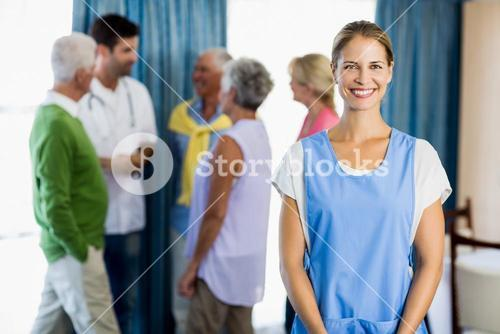 Nurse standing in front of seniors