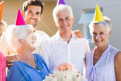 Nurse and seniors celebrating a birthday