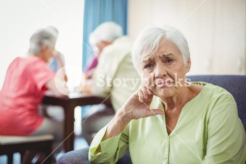 Senior woman sitting on a couch