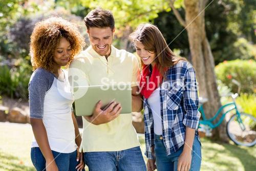 Group of friends using laptop