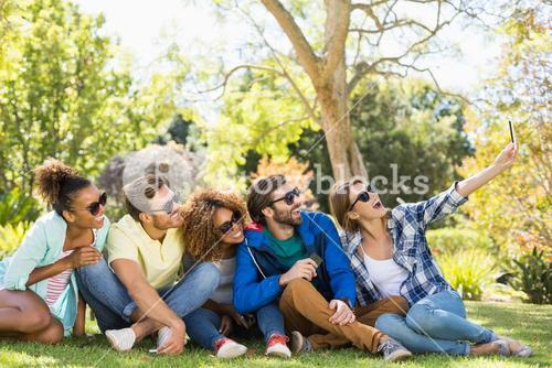 Group of friends taking a selfie with the mobile phone