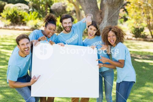 Group of volunteer holding a blank sheet and pointing to it
