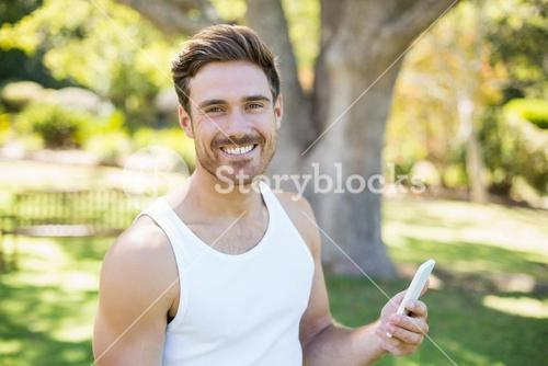 Portrait of man holding mobile phone