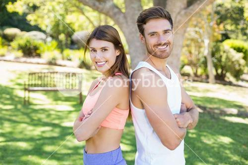 Portrait of couple standing back to back