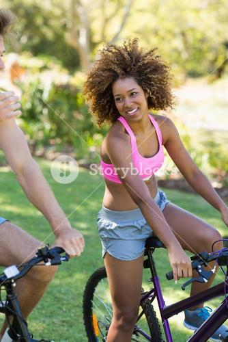 Woman smiling while cycling