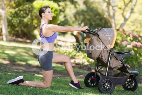 Young woman exercising with baby stroller
