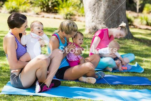 Women sitting with their babies