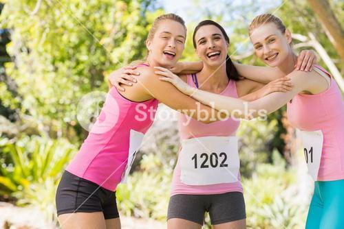 Portrait of young athlete women forming huddles