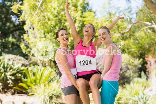 Young athlete women cheering after victory