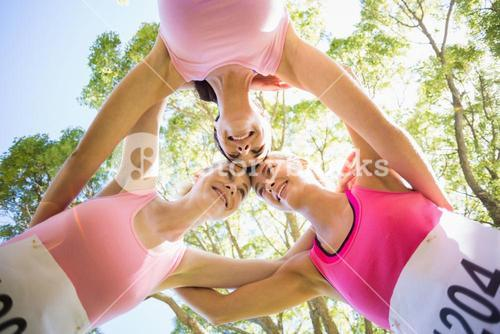 Young athlete women forming huddles
