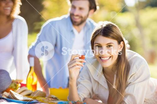 Woman in park having breakfast