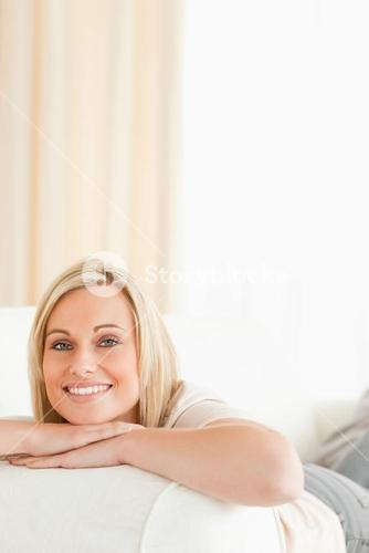 Potrait of a serene woman lying on her sofa