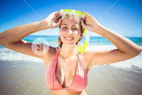 Woman posing with diving mask