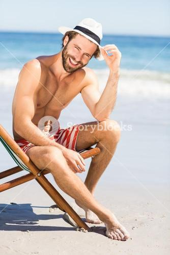 Young man sitting on armchair