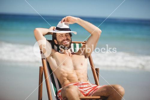 Young man relaxing on armchair